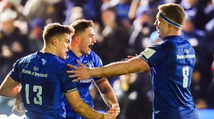 Jordan Larmour celebrates his try with Garry Ringrose and Dan Levay