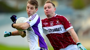 Kilmacud Crokes' Ross McGowan with Gary Rogers of Mullinalaghta