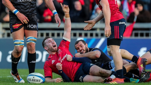 JJ Hanrahan celebrates scoring Munster's third try