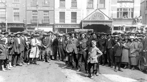 Civilians outside Dublin Castle 11 July 1921 waiting for truce to end War of Independence. Photo: Mercier Archives)
