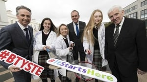 MD of BT Ireland, Shay Walsh, Minister for Education and Skills, Joe McHugh TD, and co-founder of the BTYSTE, Dr. Tony Scott with Lucan Community College students; Faye Murphy, Córa O'Toole, and Tara Phelan.
