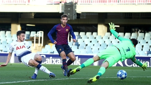 Troy Parrott scores the opening goal against Barcelona