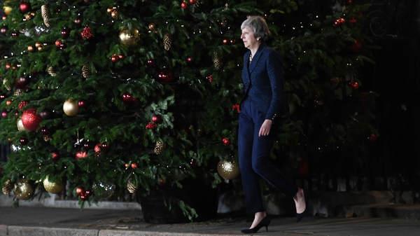 Theresa May strides out of Downing Street to address the media
