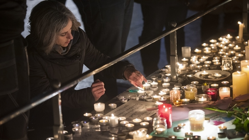 Tributes, flowers and candles were left for the dead and injured after last night's attack