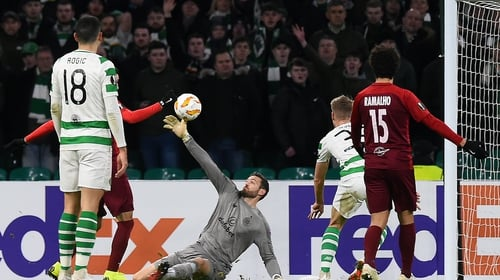 Craig Gordon is called into action during the Europa League tie against Salzburg