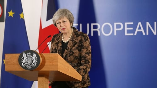 Theresa May speaking to reporters in Brussels
