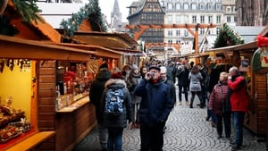 People visit the reopened Christmas Market, in Strasbourg, France, today