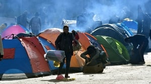 Migrants pictured in a camp at Velika Kladusa earlier this year