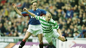 Henrik Larsson of Celtic flies through the air after a tackle from Fernando Ricksen back in 2003