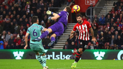 Austin heads into an empty net after Bernd Leno couldn't get a hand on Shane Long's cross