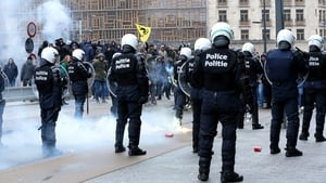 Police officers step in to disperse around 1,000 far-right, anti-migration protesters near EU buildings in Brussels
