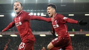Xherdan Shaqiri (L) celebrates with Roberto Firmino