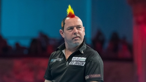 World No 3 Peter Wright has been knocked out of the PDC World Championship at Alexandra Palace in London this evening