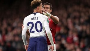 Dele Alli reacts after being hit by a bottle