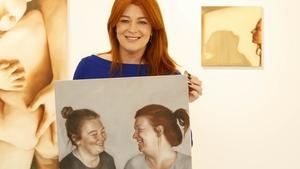 RTÉ's Bláthnaid Ní Chofaigh  pictured with her portrait at the opening of Birthmarks by Dublin artist Siobhán O'Callaghan