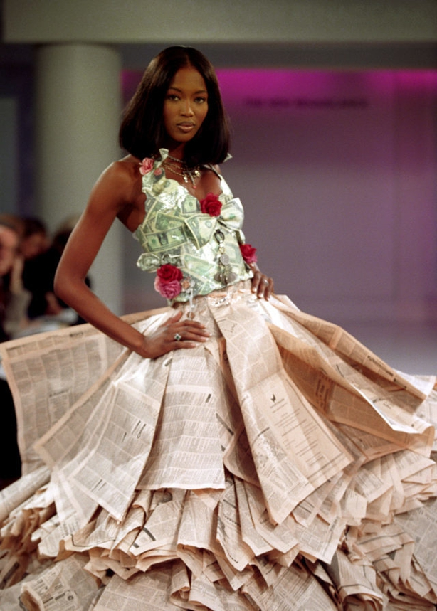 (Neil MunnsPA) Model Naomi Campbell wearing a wedding dress made from newspapers and dollar bills as part of the New Renaiscance collection at the Harvey Nicols and Perrier New Generation Designers Show.
