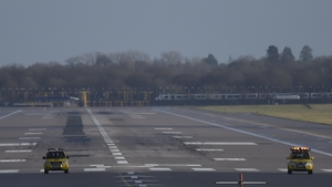 Service vehicles on the runway as flights at Gatwick Airport are halted