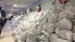 Thousands of food parcels lined up ready for distribution