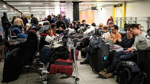 Passengers waiting at Gatwick Airport earlier this morning
