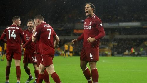 Virgil Van Dijk celebrates his goal against Wolves