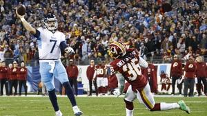 Blaine Gabbert of the Tennessee Titans throws a touchdown pass