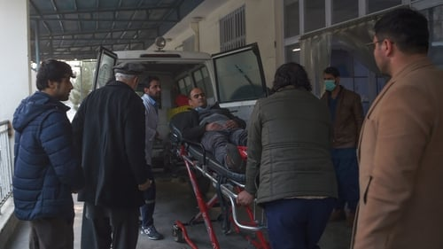 A wounded man is moved to hospital following the attack