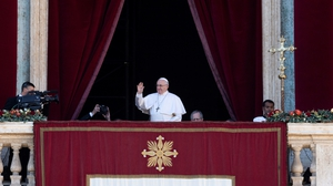 Pope Francis addressing crowds from a balcony in The Vatican