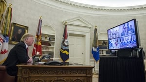 Donald Trump makes a video call to service members from the Oval Office