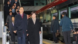 South Korea's Unification Minister Cho Myoung-gyon and others board the train to North Korea ahead of the ceremony