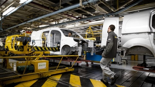 A Renault employee works on vehicle production assembly line at the Renault factory in Maubeuge, north-eastern France