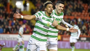 Scott Sinclair (L) celebrates with Tom Rogic after scoring his and Celtic's second goal