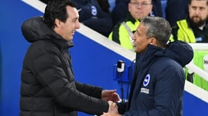 Unai Emery (L) with opposite number Chris Hughton after the game