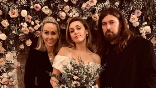 Billy Ray Cyrus at his wife Tish with their daughter Miley