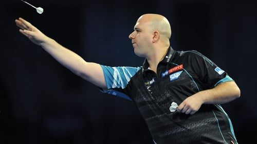 Reigning champion Rob Cross crashed out