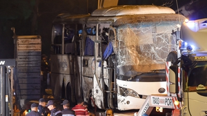 The bus from yesterday's attack in which four people were killed is removed from the scene
