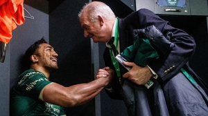 Bundee Aki celebrates with Connacht Rugby President Mossy Moran