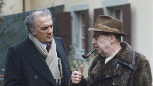 Georges Simenon (right) with legendary Italian film director Federico Fellini in 1977. (Photo: Jacques Haillot/Sygma via Getty Images)