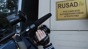A journalist films the sign on the RUSADA (Russia's anti-doping agency)