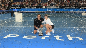 Switzerland's Federer and Bencic with the Hopman Cup