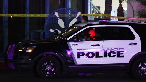 Police guard the Gable House Bowl centre in Torrance, California
