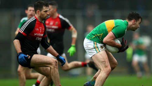 Leitrim's Dean McGovern under pressure from Ger Cafferkey of Mayo