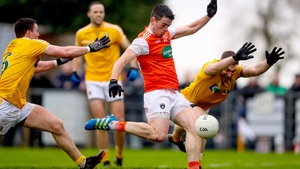 Antrim's Declan Lynch and Michael McCarry try to tackle Jack Grugan of Armagh