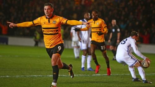 Padraig Amond (L) celebrates after scoring Newport's second