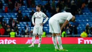 Sergio Ramos and team-mate Karim Benzema react as they leave the pitch after Real Madrid lose to Real Sociedad