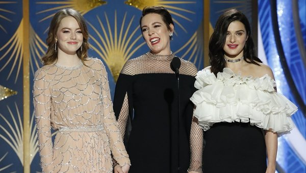 (L-R) The Favourite stars Emma Stone, Olivia Colman and Rachel Weisz onstage at the Golden Globes