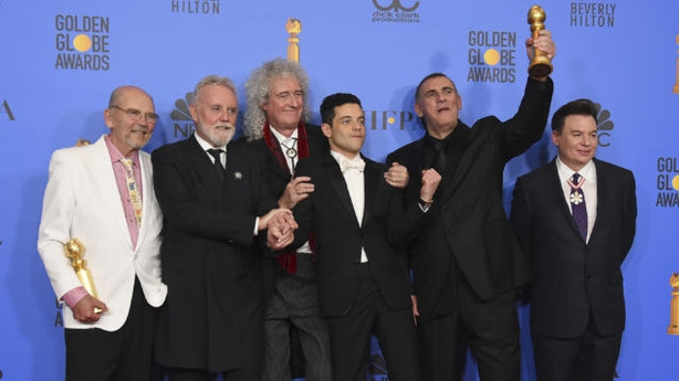"""Jim Beach, from left, Roger Taylor, Brian May, Rami Malek, Graham King, and Mike Myers pose in the press room with the award for best motion picture, drama for """"Bohemian Rhapsody"""" at the 76th annual Golden Globe Awards at the Beverly Hilton Hotel on Sunday, Jan. 6, 2019, in Beverly Hills, Calif. (Photo by Jordan Strauss/Invision/AP)"""