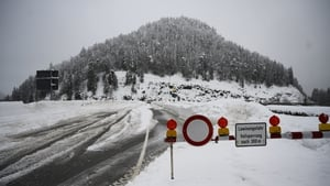 Roads are closed after an avalanche in Austria