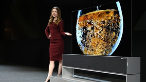 South Korean giant LG unveiled its ultra-high definition television that rolls into and out of a base stand at CES in Las Vegas