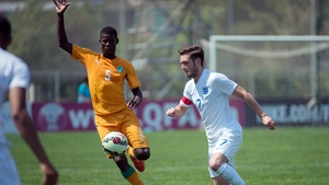 Vakoun Issouf Bayo (l) in action for the Ivory Coast