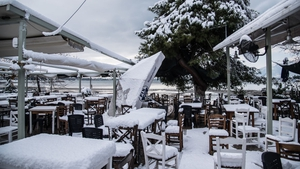 Snowfall at the beach of Nea Artaki/Chalkida on the island Euboea, Greece